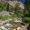 Views of Grizzly Creek and the canyon walls.- Grizzly Creek Trail