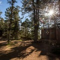 At the base of the granite outcroppings you'll find a small meadow, a cabin, and restrooms.- Devils Head Lookout