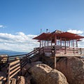 The view of the lookout with Pike's Peak in the distance.- Devils Head Lookout