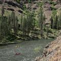 Boaters enjoying the sheer canyon walls along the Grande Ronde River.- Grande Ronde River: Minam to Troy