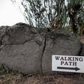 The trail skirts the edge of a golf course with signs to keep you on track.- Dragon's Teeth