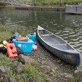 Packing a canoe for an overnight on Long Island, Willapa Bay National Wildlife Refuge.- Willapa Bay National Wildlife Refuge, Long Island Unit
