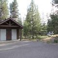 One of numerous vault toilet facilities.- Crane Prairie Campground