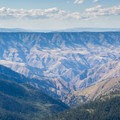 Peering into Hells Canyon, the deepest canyon in North America.- Heavens Gate Lookout