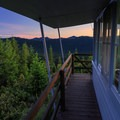 Sunrise view from the west deck.- Gold Butte Lookout