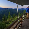 Contributor Dan Sherman takes in the view before sunrise from the west deck.- Gold Butte Lookout