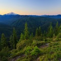 Mt Jefferson and the distant Three Sisters to the right wth the trail in the foreground.- Gold Butte Lookout