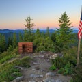 Woodshed and flag pole.- Gold Butte Lookout