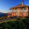Morning light on the lookout and Mount Jefferson.- Gold Butte Lookout
