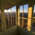 View of Mount Jefferson from inside the lookout.- Gold Butte Lookout
