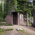 One of two vault toilets at the campground.- Seven Devils Campground
