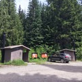 Vault toilets and a day use parking area.- Elk Lake, Bull of the Woods Wilderness