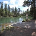 Wyeth Campground's run-down boat ramp. If you view the picture in full-size, you will see a large section of the upriver side of the boat ramp is completely missing, as well as several sections under the clear water on the downriver side.- Wyeth Campground, Deschutes River
