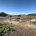 Covered tables at the parking area with Rattlesnake Mountain in the background.- Rattlesnake Mountain