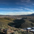 Panoramic view from the top. Mount Rose stands toward the right.- Rattlesnake Mountain