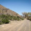 A gravel road leads the last portion of the ranch house property.- McCarran Ranch Preserve River Trail