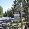 The entrance to Big Lake Campground off of Big Lake Road.- Big Lake Campground