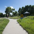 Pedestrian trail adjacent to the South Platte River Trail at the Downtown Aquarium near Confluence Park.- Confluence Park