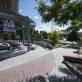 Shade structure and seating in the northeast corner of Denver's Confluence Park.- Confluence Park