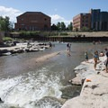 Locals playing at Confluence Park at the confluence of the South Platte River and Cherry Creek.- Confluence Park