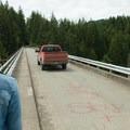 A truck drives over the High Steel Bridge, Forest Road 2340..- High Steel Bridge