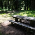 Picnic tables just off of the road.- Wildwood Falls Swimming Hole