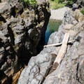 Indications of high flows along the rocks.- Wildwood Falls Swimming Hole
