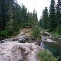 Rocks for sitting and sun bathing.- Box Canyon Creek Swimming Hole