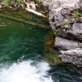 Log jam and hidden rocks.- Box Canyon Creek Swimming Hole