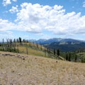 See Quadrant Mountain, Antler Peak, Dome Mountain, and Mount Holmes to the south.- Sepulcher Mountain