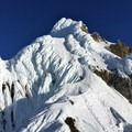 Looking toward the crux of the route - steep snow fields and a traverse amongst the gendarmes.- Mount Hood South Route: Flying Buttress and Wy'east Ridge Variation