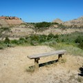 A bench at the overlook.- Painted Canyon Visitor Center Trails