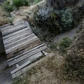A small footbridge missing planks is an indication of the neglect of this trail.- Beale's Cut