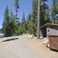 Vault toilets and a dumpster near the boat ramp.- Little Cultus Lake Campground