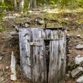Abandoned mine shaft in Stewart Canyon.- White Knob Range Traverse