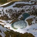 Mirror shaped lake in the basin below Cabin Mountain.- White Knob Range Traverse