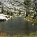 A long thin lake stretches near the main lake.- Boulder Creek Lakes