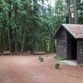 Vault toilet at Round Lake State Park Campground.- Round Lake State Park Campground