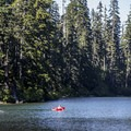 A visitor with a flotation device enjoys the warm temperature of the shallow lake.- Soda Peaks Lake