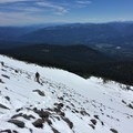 Leaving Hidden Valley via the standard hiking route. Exposed sidehills of scree and slush - not ideal.- Mount Shasta: West Face Route