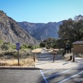 The beginning of the .5-mile trail begins behind the gate.- Red Rock Pool