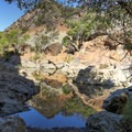 There are multiple coves and beaches around the crescent-shaped pool.- Red Rock Pool