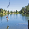 Taking the drop from the rope swing at Bloods Lake.- Bloods Lake