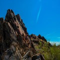Jagged rock formations are all along either side of the trail as you climb.- Piestewa Peak Summit Trail, Phoenix Mountain Preserve