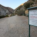 Signs noting that the Bridge to Nowhere and surrounding land lies on private property.- Bridge to Nowhere / East Fork San Gabriel River Trail