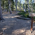 A trail sign marks the direction of the hike at Icehouse Saddle.- Ontario Peak
