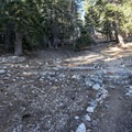 Kelly Backcountry Camp, where the trail continues through a building foundation.- Ontario Peak