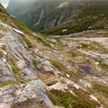 Scrambling onto the Long Range plateau from the Western Brook Pond ravine, looking back down toward the ravine.- The Long Range Traverse