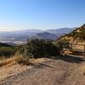The trail begins past an unmarked gate.- Knapp's Castle