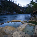 Remington hot springs tubs set beside the Kern River.- Remington Hot Springs